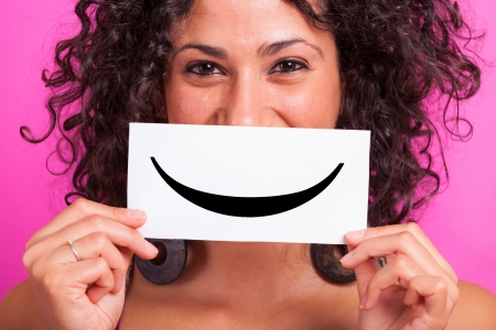 beautiful smile: Young Woman with Smiley Emoticon on Fuchsia Background