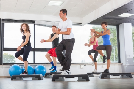 step fitness: Aerobics Class in a Gym