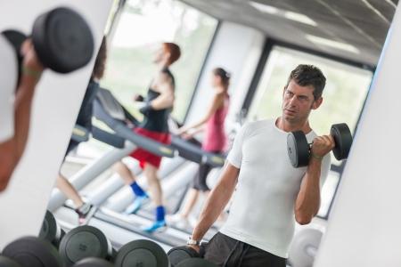 Man Lifting Weights at Gym Stock Photo - 15404682