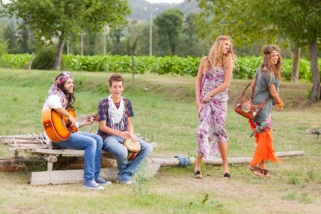 Hippie Group Playing Music and Dancing Outside photo