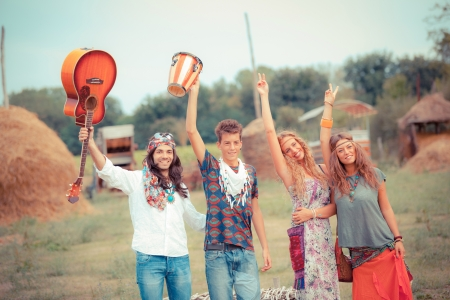70s adult: Hippie Group Playing Music and Dancing Outside Stock Photo