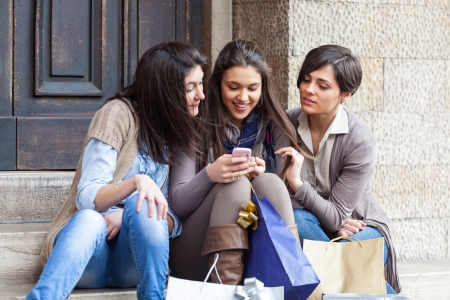 using phone: Group of Women Sending Message with Mobile Phone