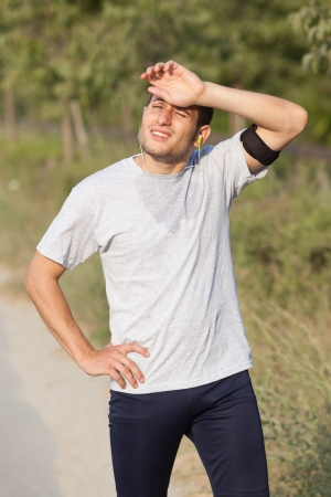 Tired Young Man After Jogging Stock Photo - 15711839