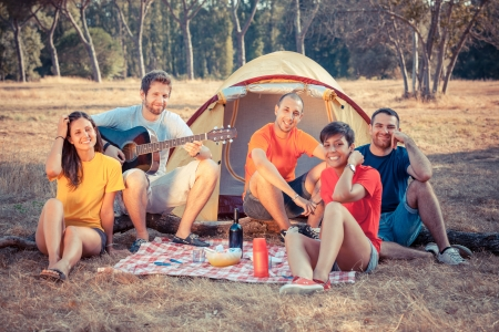 student travel: Group of People Camping and Singing