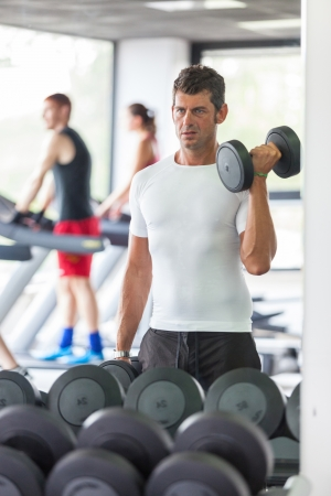 Man Lifting Weights at Gym photo