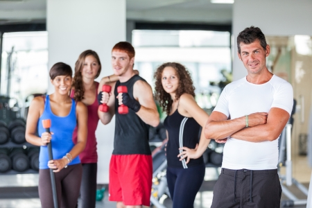 gym clothes: Group of People at Gym with Instructor Stock Photo