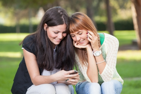 Two Young Women with Mobile Phone photo