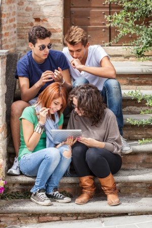 high tech device: Group of Teenage Friends with Tablet PC