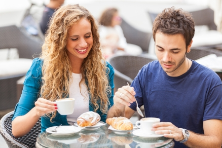 Young Couple Having a Traditional Italian Breakfast photo
