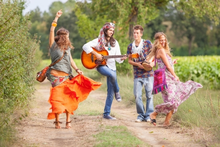 70s disco: Hippie Group Playing Music and Dancing Outside Stock Photo