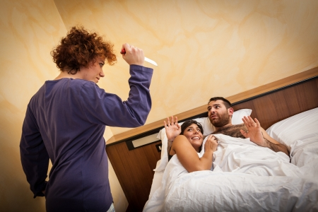 love affair: Man with Lover Caught by his Wife Stock Photo