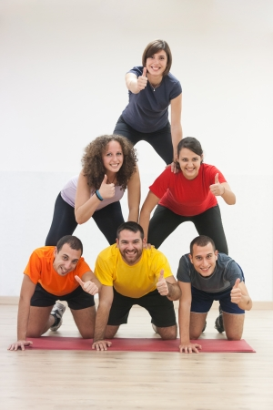 Human Pyramid and Thumbs Up Stock Photo