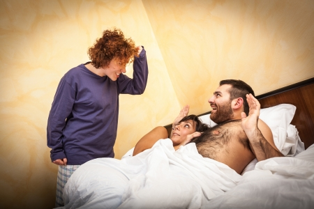 unfaithfulness: Man with Lover Caught by his Wife Stock Photo