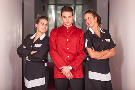 doorkeeper: Bellboy with Two Beautiful Chambermaids Stock Photo