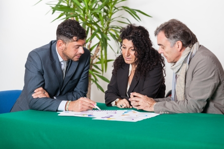 bank manager: Mature Couple with Financial Consultant Stock Photo