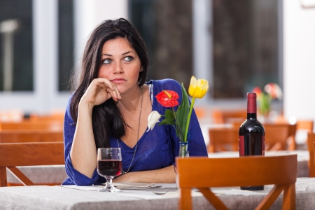 bored face: Bored Woman Alone at Restaurant