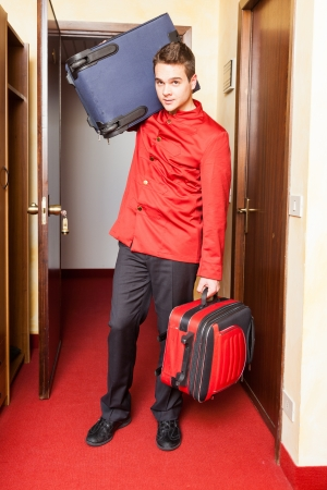 bellhop: Tired Bellboy with Luggages