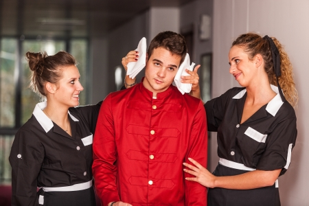 Chambermaids Helping Bellboy photo