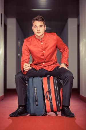 doorkeeper: Tired Bellboy with Luggages