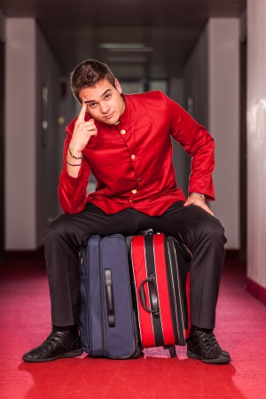 Tired Bellboy with Luggages photo