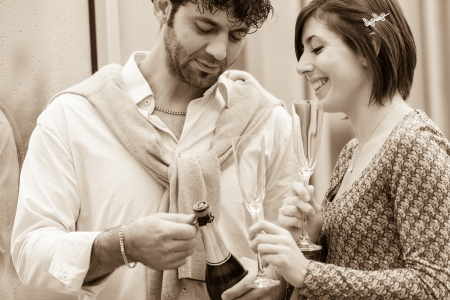 Romantic Young Couple Toasting and Drinking photo