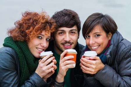 Group of Friends with Hot Drink on Winter photo
