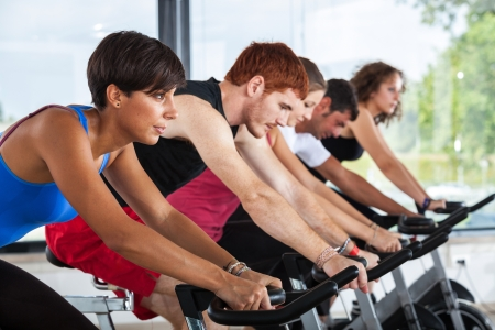 exercise machine: Group of People Cycling at Gym