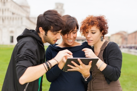 young adults: Group of Friends with Tablet PC Outside