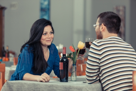 Romantic Young Couple at Restaurant photo