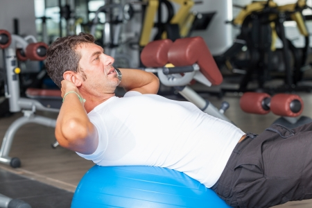 Man Doing Exercises for Abdominal photo