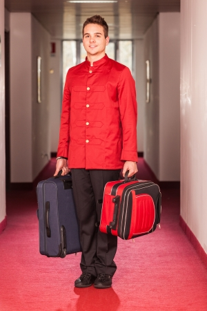 Bellboy with Luggages in the Hallway photo
