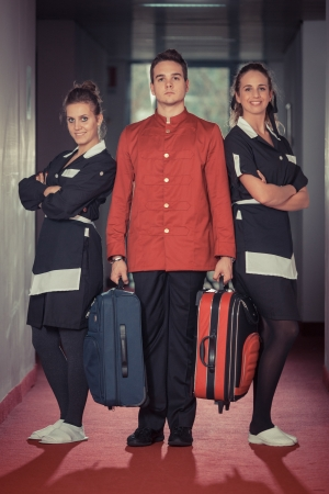porter: Bellboy with Two Beautiful Chambermaids Stock Photo