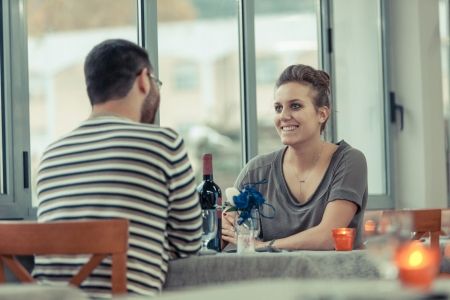 dinner date: Romantic Young Couple at Restaurant