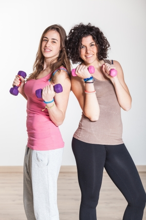 Two Women with Light Weights at Gym photo