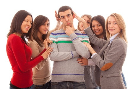 seductive women: Young Handsome Man with Many Girls Around Stock Photo