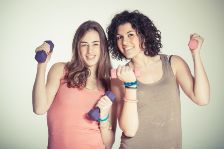 excercise: Two Women with Light Weights at Gym Stock Photo