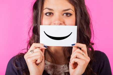 Happy Young Woman with Smiley Emoticon Stock Photo - 17469214