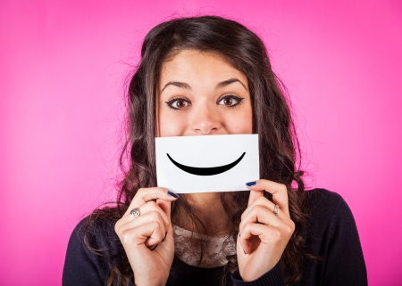 Happy Young Woman with Smiley Emoticon photo