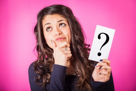 doubtful: Doubtful Woman holding Question Mark Stock Photo