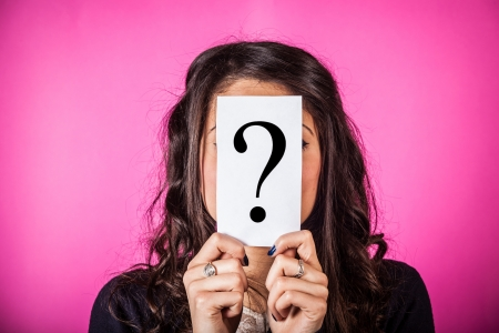 Doubtful Woman holding Question Mark Stock Photo - 17469427