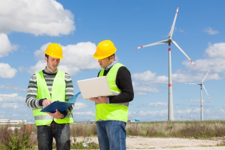 energy production: Two Engineers in a Wind Turbine Power Station