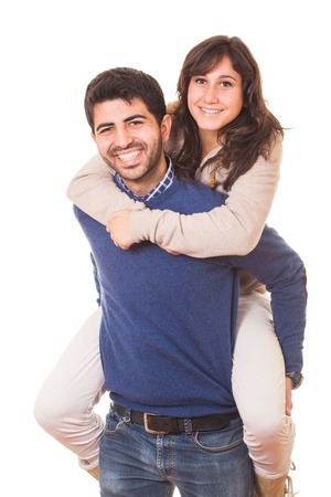 Young Man Giving a Piggyback to His Girlfriend photo