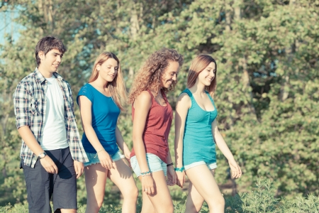 Group of Teenage Friends Walking at Park photo