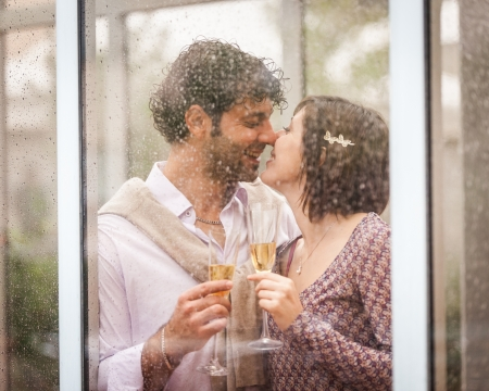 love in rain: Romantic Young Couple Toasting and Drinking