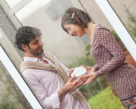 Romantic Young Couple with Gift for Her photo
