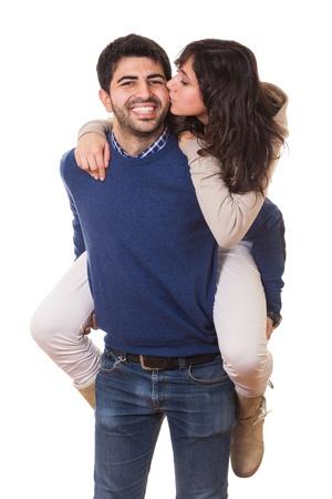 enamorados besandose: Chica joven besando a su novio