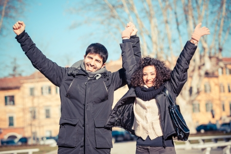 arms  outstretched: Happy Young Couple with Outstretched Arms