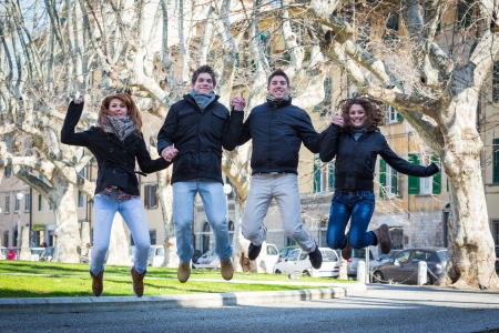 Happy Group of Friends Jumping Outdoor photo