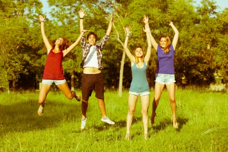 Group of Teenagers Jumping at Park photo