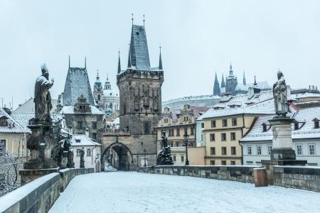 Snow Covered Charles Bridge in Prague photo